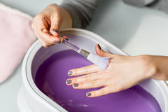 Female hands in a paraffin wax bowl Royalty Free Stock Photography