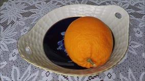 Female hands peeling a fresh orange stock footage
