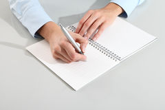 Female hands with pen writing on notebook Royalty Free Stock Images