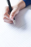 Female hands with pen writing on paper Royalty Free Stock Image