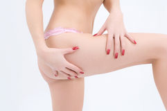 The female hands pinch on a hip. Female hands pinch on a hip Stock Photography