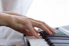 Female hands play the synthesizer. royalty free stock photos