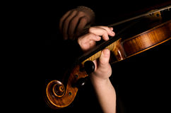 Female hands play a violin Royalty Free Stock Photography