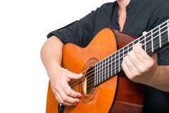 Female hands playing an acoustic guitar Stock Photos