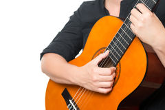 Female hands playing an acoustic guitar Royalty Free Stock Photos