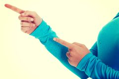 Female hands pointing on copy space. Royalty Free Stock Images