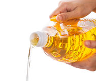 Female Hands Pouring Vegetable Oil I Stock Photo