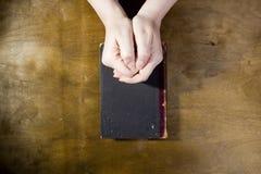 Female hands in prayer Stock Images