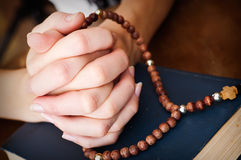 Female hands praying Stock Photo