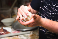 Female hands prepare a classic Caucasian khychin. Dish in the kitchen in the mountain village Stock Images