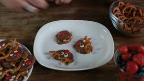 Female hands preparing Christmas chocolate cookies stock video