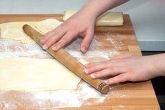 Female hands preparing dough for baking Stock Image