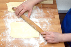Female hands preparing dough for baking Stock Photo