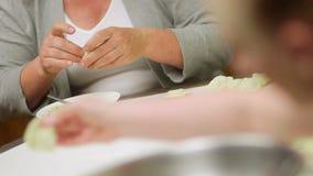 Female hands preparing dumplings stock video footage