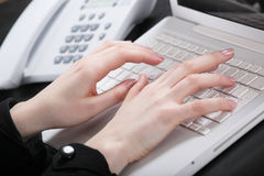 Female Hands Print The Text On Keyboard Stock Photography