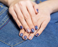 Female hands with professional blue and silver manicure Royalty Free Stock Photos