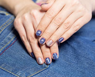 Female hands with professional blue and silver manicure Stock Photography