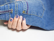 Female hands with professional blue and silver manicure Stock Photo