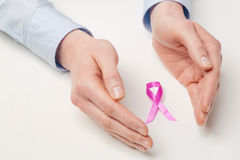 Female Hands Protecting Pink Ribbon Royalty Free Stock Image