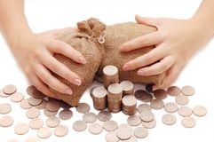 Female hands protects bags with money Royalty Free Stock Photo