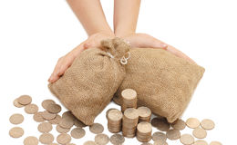 Female hands protects bags with money Royalty Free Stock Photos