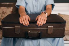 Female hands  putting on luggage. Stock Photo