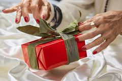 Female hands and red gift box. royalty free stock image