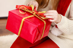 Female hands with red gift box Royalty Free Stock Photos