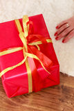 Female hands with red gift box. Occasions gifts people concept. Christmas xmas winter season. Woman opening or wrapping red box gift Royalty Free Stock Image
