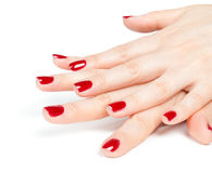 Female hands with red manicure Stock Photography