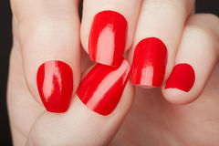 Female hands with red nail polish close up Stock Images