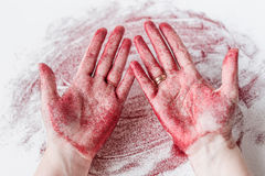 Female hands in red sequins. Palm in decorative glitter Stock Image