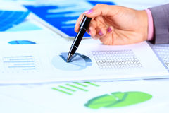 Female hands reviewing accounting documents Stock Photography