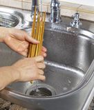 Female hands rinsing off bamboo chopsticks Royalty Free Stock Photography