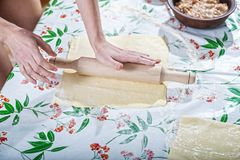 Female hands rolling out dough for homemade baking. Preparation of baking Royalty Free Stock Photo