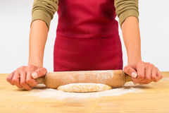 Rolling dough on table Stock Photography