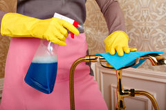 Female hands in rubber gloves cleans bathroom Stock Photo