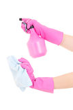 Female hands in rubber gloves with spray and rag Royalty Free Stock Image