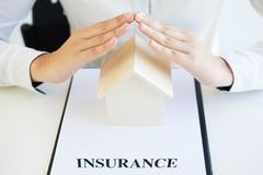 Female hands saving small house, Real estate business. insurance Royalty Free Stock Photography