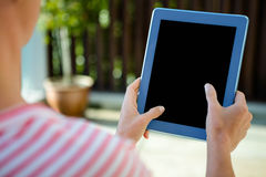 Female hands scrolling on a tablet computer Stock Image