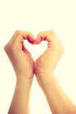 Female hands in shape of heart. Love and help. Smoothy female hands in shape of heart sign symbol of charity and fondness royalty free stock images