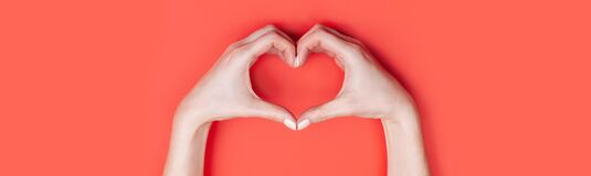 Free Female Hands Show A Heart Symbol On A Red Background. Place For Text, Copy Space Royalty Free Stock Image - 170562256