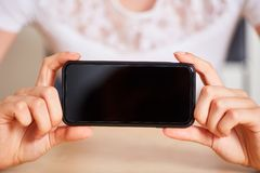 Hands show blank screen from the smartphone. Female hands show the blank screen from a smartphone stock images