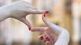 Female hands showing frame gesture, photo angle and lights tips, photography. Stock footage stock video footage