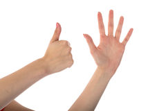 Female hands showing six fingers isolated on white Stock Photo