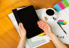 Female hands showing something in her tablet Royalty Free Stock Images