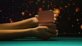 Female hands shuffling playing cards, showing ace bluff, gambling business. Stock footage stock footage
