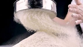 Female hands sifting flour stock video