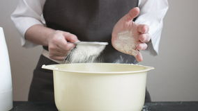 Female hands sifts the flour stock footage