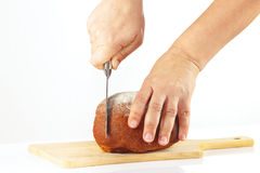 Female hands sliced rye bread on a cutting board Stock Photography
